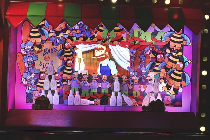 Внутри Симпсонов разные персонажи общаются с тобой, чтобы скрасить очередь.